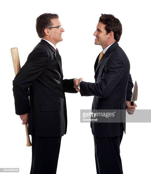 business men crooked deal - con man stock photos and pictures