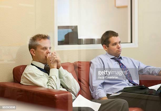 Business men in contemplation
