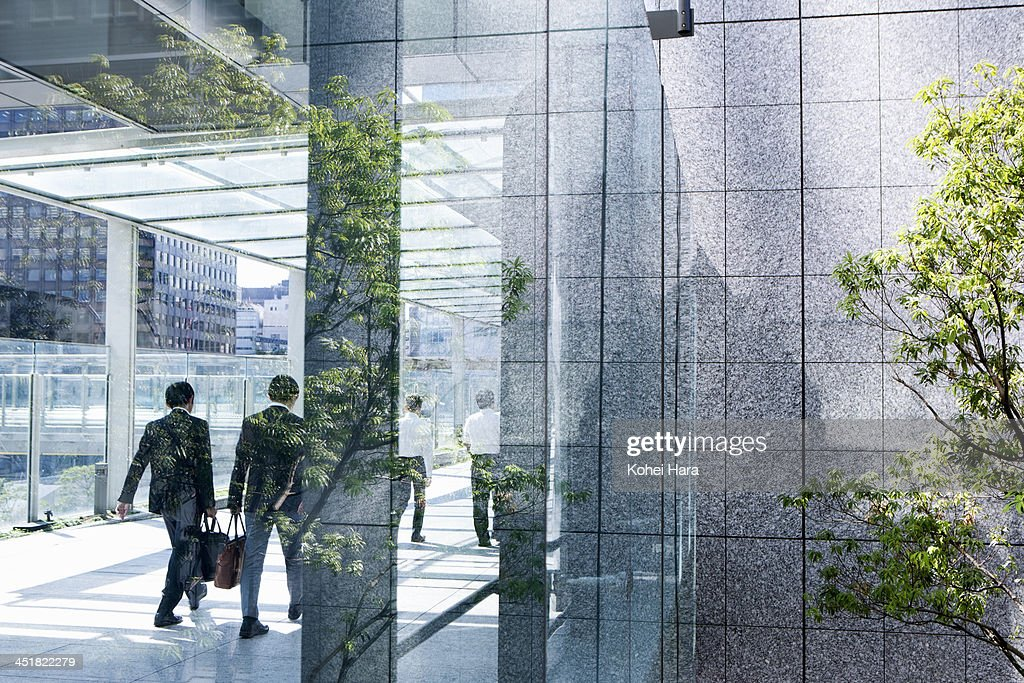 business men in office building : Stock Photo