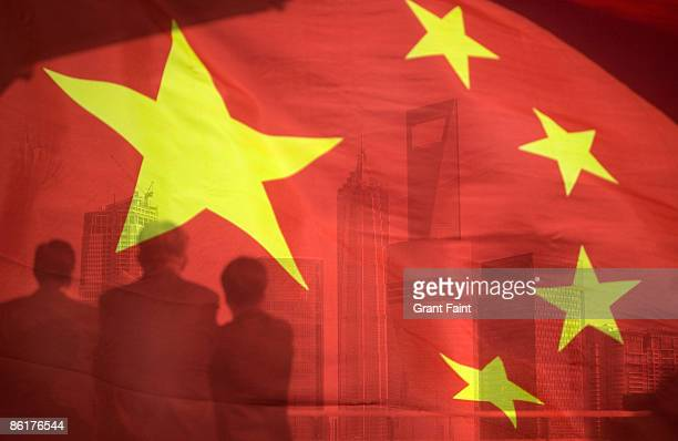business men looking out through chinese flag - chinese flag stock pictures, royalty-free photos & images