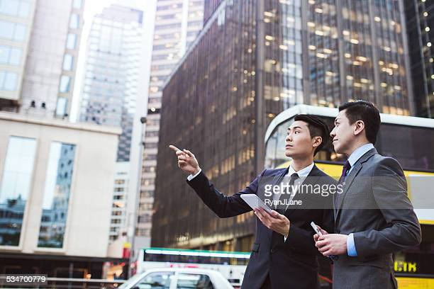 Business Men Planning in Hong Kong