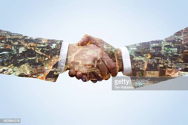 business men shaking hands with city view at night - agreement stock pictures, royalty-free photos & images