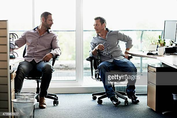 business men talking in modern office - office chair stock pictures, royalty-free photos & images