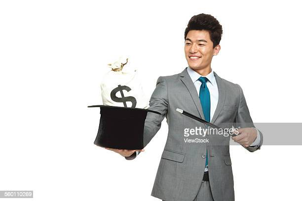 business men took the magic cap - zaubertrick stock-fotos und bilder