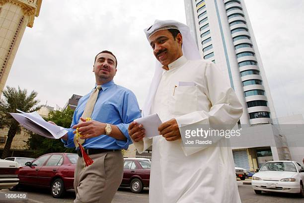 Business men walk through the streets November 30 2002 in Kuwait City Kuwait With a possible war with Iraq in the future business men are hoping that...