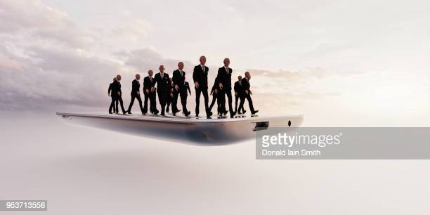 business men walking on mobile phone - cloning stock pictures, royalty-free photos & images