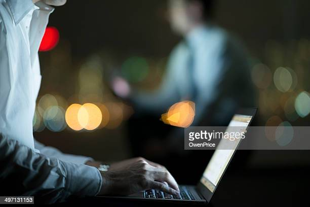 Business men working late night time background