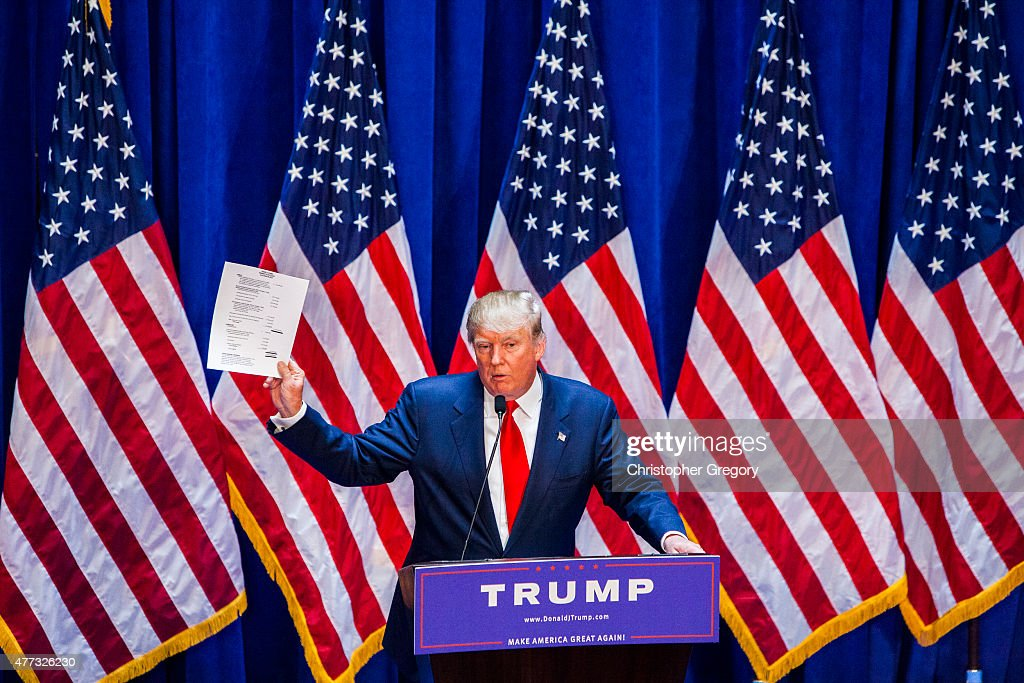 Business mogul Donald Trump holds documents certifying his net worth is 8.7 billion dollars as he announces his candidacy for the U.S. presidency at Trump Tower on June 16, 2015 in New York City. Trump is the 12th Republican who has announced running for the White House.