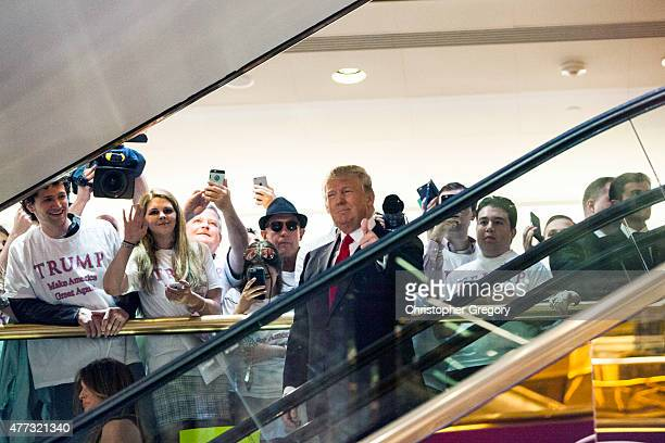 Business mogul Donald Trump rides an escalator to a press event to announce his candidacy for the U.S. Presidency at Trump Tower on June 16, 2015 in...