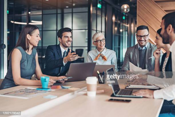 business negotiations - merger stock pictures, royalty-free photos & images