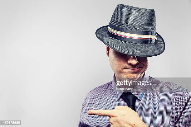 Business Nerd with hat on pointing