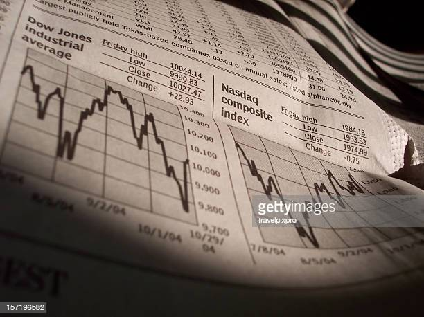 business news stock charts from newspaper - dow jones industrial average stock pictures, royalty-free photos & images