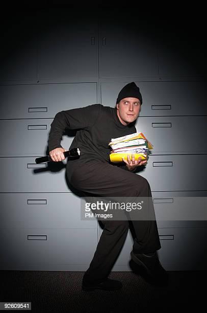 business office burglar  - falsenews stock pictures, royalty-free photos & images