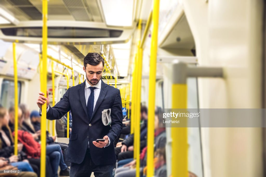 Business on the go - Commuting in the morning in London : Stock Photo