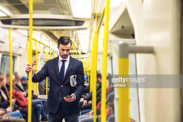 business on the go - commuting in the morning in london - underground stock photos and pictures