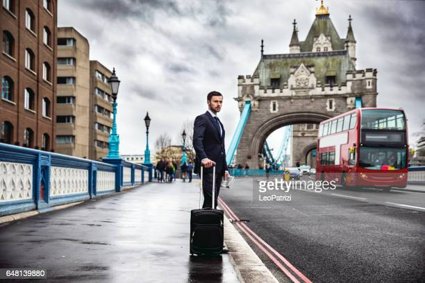 Business on the go - Young businessman walking in Tower Bridge area on business trip
