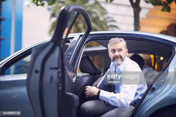 business on the move, riding a car. - car pooling stock photos and pictures