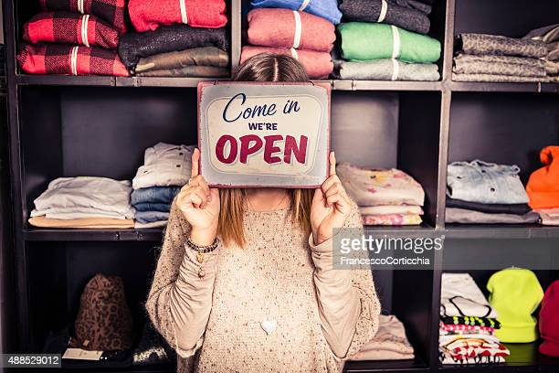 business opening with open sign - store opening stock pictures, royalty-free photos & images