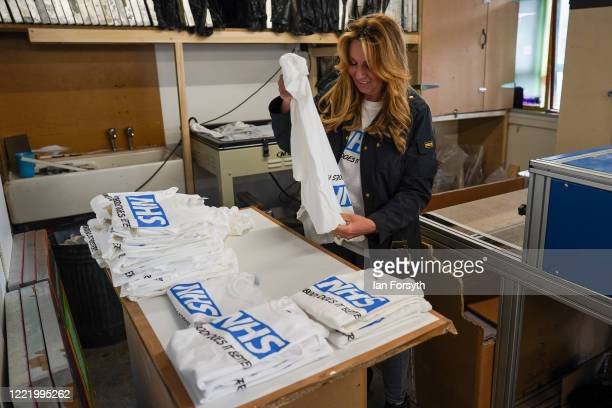 Business owner Alison Hylton folds NHS branded t-shirts after a screen printing run on April 30, 2020 in Hartlepool, England. Mrs Hylton's normal...