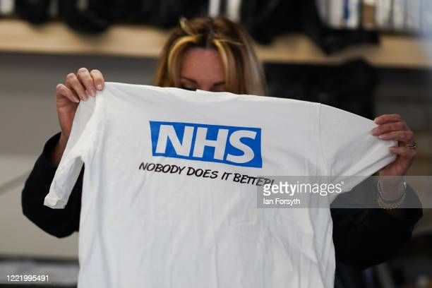 Business owner Alison Hylton inspects a finished product as she produces NHS branded t-shirts on April 30, 2020 in Hartlepool, England. Mrs Hylton's...