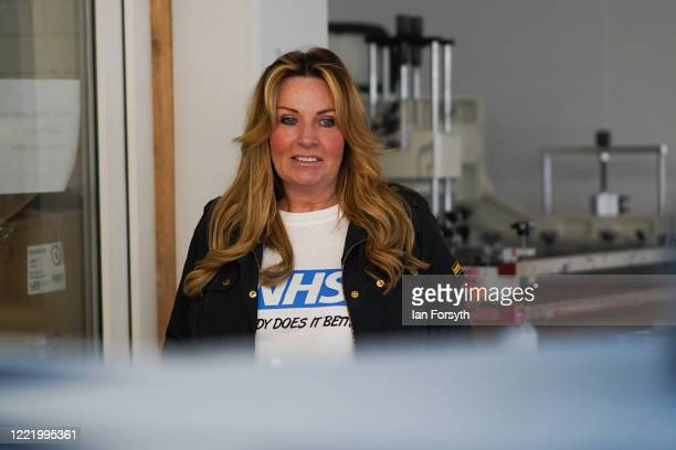 Business owner Alison Hylton watches the production process as she produces NHS branded t-shirts on April 30, 2020 in Hartlepool, England. Mrs...
