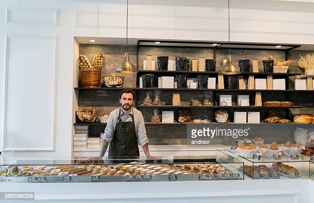 business owner at a bakery shop - bakery stock pictures, royalty-free photos & images