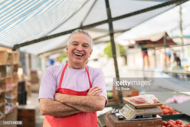 business owner at farmer's market - happy merchant stock pictures, royalty-free photos & images
