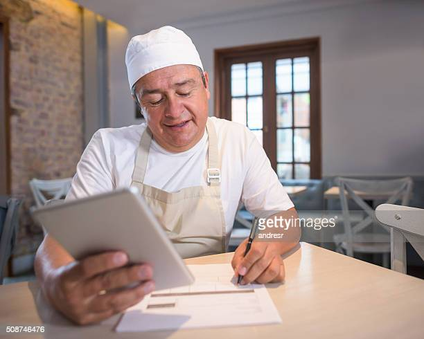 Business owner doing the books at a coffee house