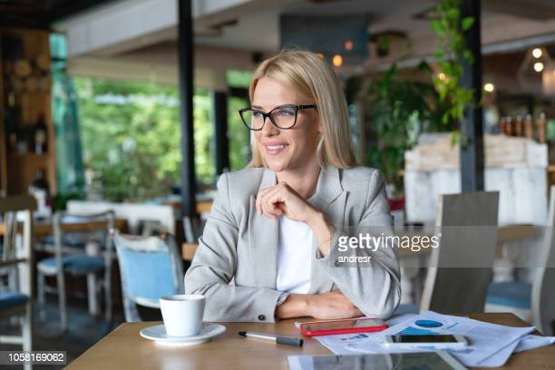 business owner doing the books at a restaurant - business plan stock pictures, royalty-free photos & images