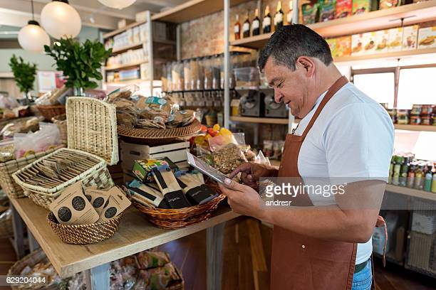 Business owner doing the inventory at a grocery shop
