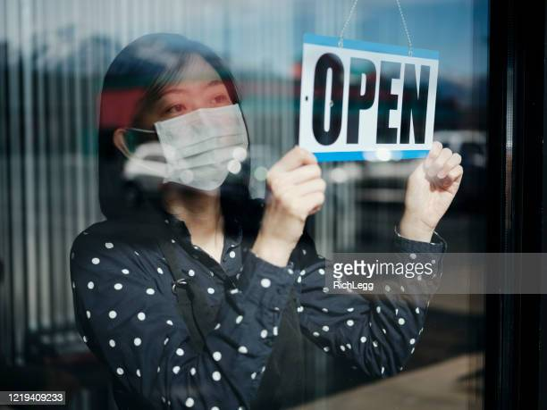 business owner open sign - essential workers stock pictures, royalty-free photos & images