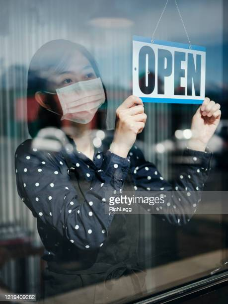 business owner open sign - open for business stock pictures, royalty-free photos & images