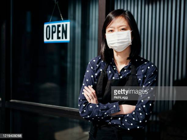business owner open sign - essential services stock pictures, royalty-free photos & images