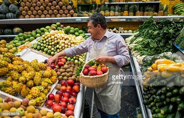 Business owner organizing fruits at a grocery store