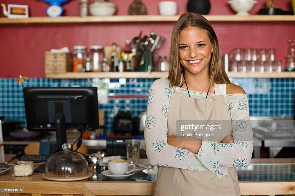 Business owner standing in cafe : Stock Photo