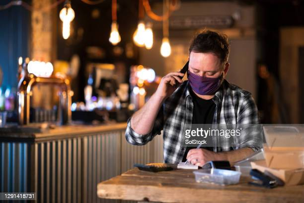 business owner taking an order - take away food stock pictures, royalty-free photos & images