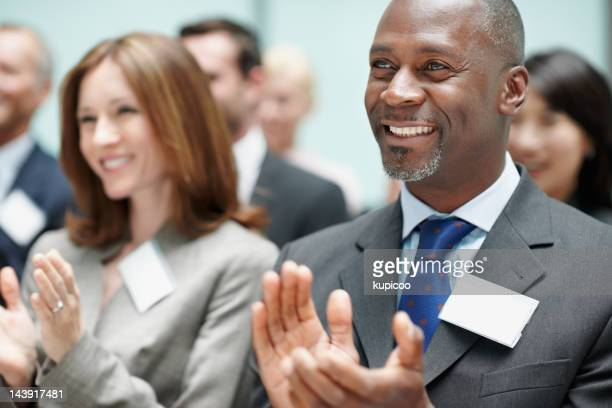 Business partners applauding after presentation