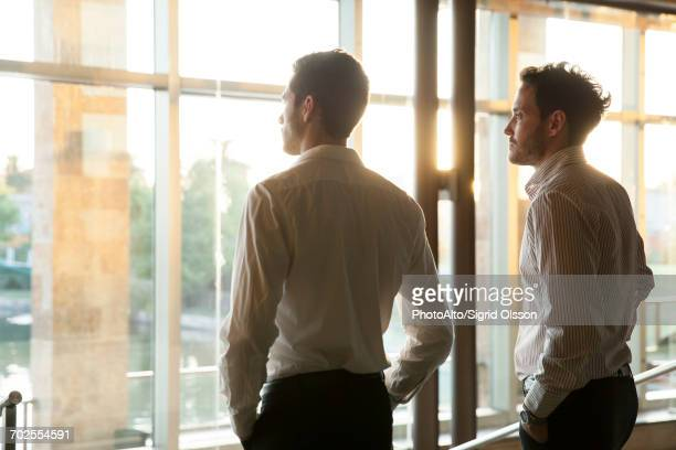 Business partners contemplating future together