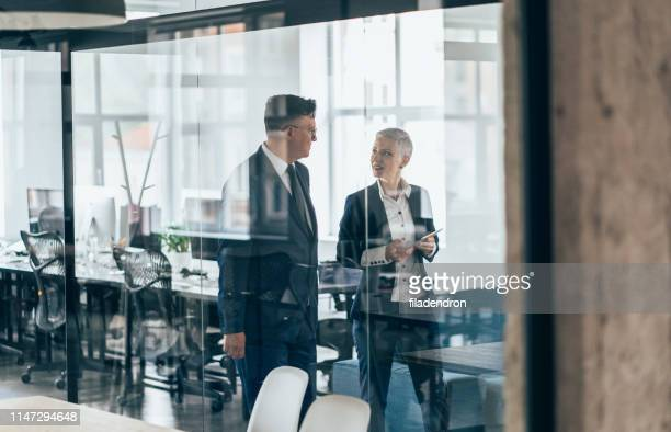 business partners in discussion - discussion stock pictures, royalty-free photos & images