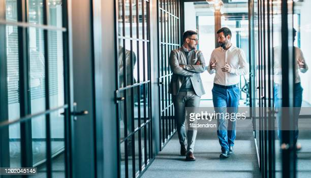 business partners in discussion - partnership stock pictures, royalty-free photos & images