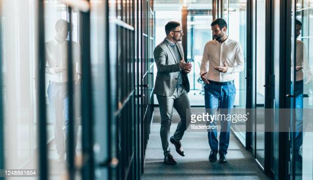 business partners in discussion - colleague stock pictures, royalty-free photos & images