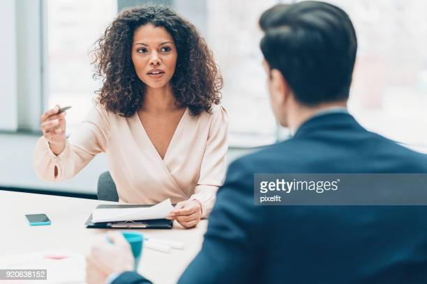 business partners in discussion - serious stock pictures, royalty-free photos & images