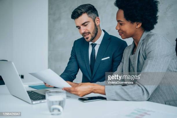 business partners in meeting. - mid adult stock pictures, royalty-free photos & images