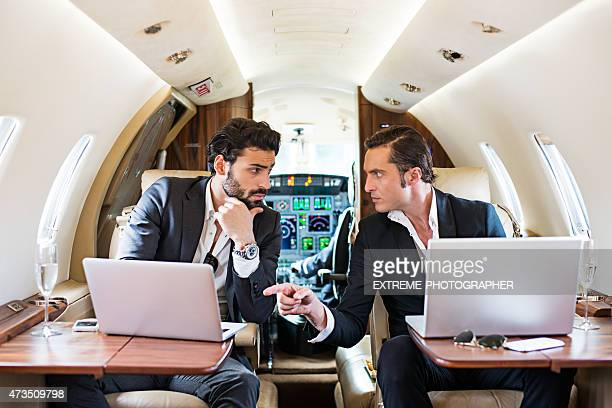 Business partners in private airplane