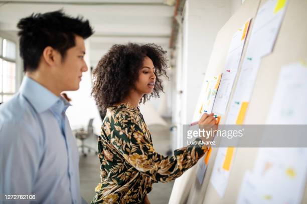 business partners planning new strategies - diversity stock pictures, royalty-free photos & images