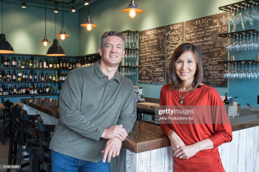 Business partners smiling in wine bar : Stock Photo
