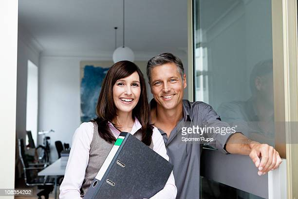 Business partners smiling to camera