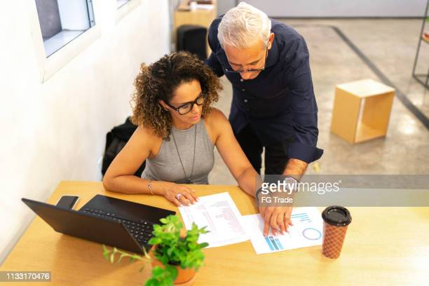 business partners working together at startup modern office - business plan stock pictures, royalty-free photos & images