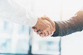 Business partnership meeting. Picture businessmans handshake. Successful businessmen handshaking after