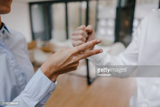 business peolpe making descisions, playing scissors paper stone - konflikt stock-fotos und bilder
